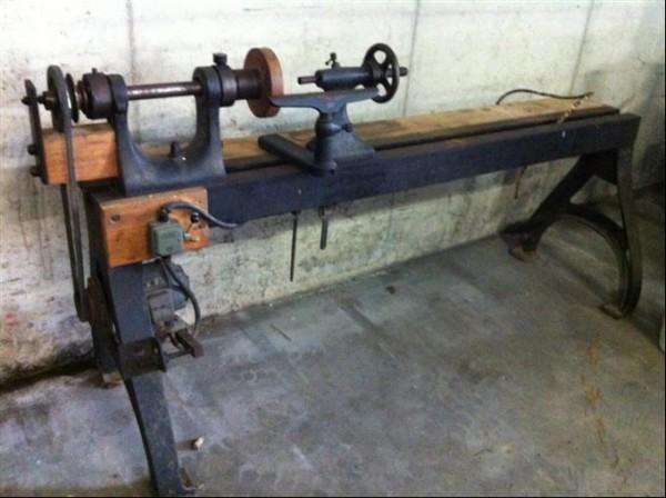 heavy antique woodturning machine, wood lathe